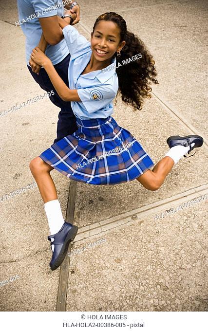 School girl dancing salsa in center plaza