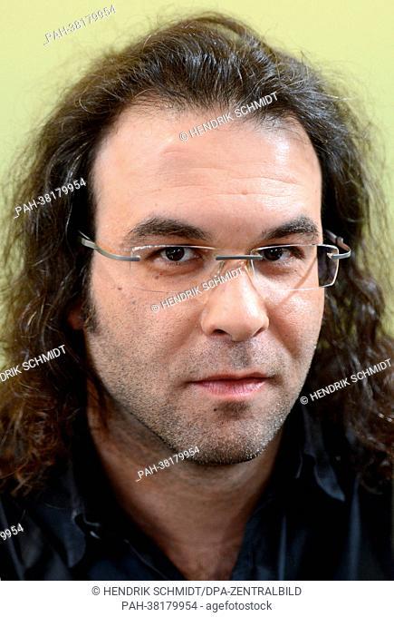 Greek writer Christos Ikonomou poses for photos as he presents his new book ('Warte nur, es passiert schon was. Erzaehlungen aus dem heutigen Griechenland'...