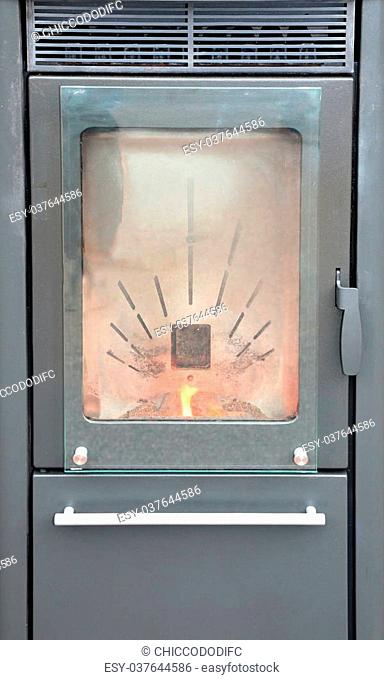 vertical modern wood-burning stove to heat House in winter