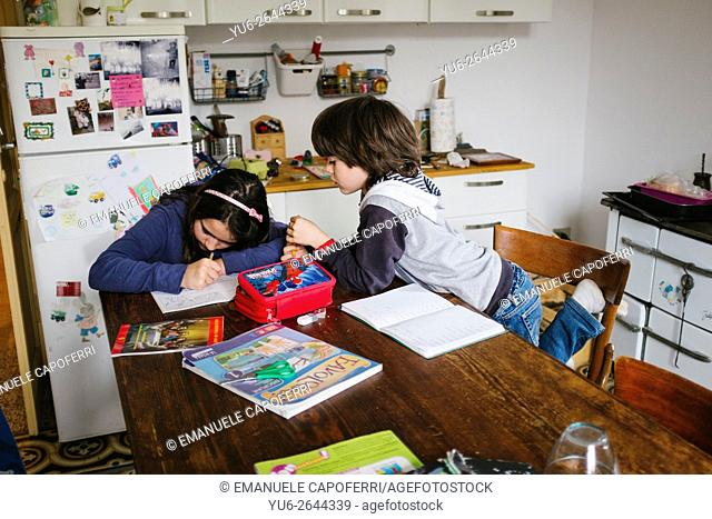 Children place their homework in the kitchen