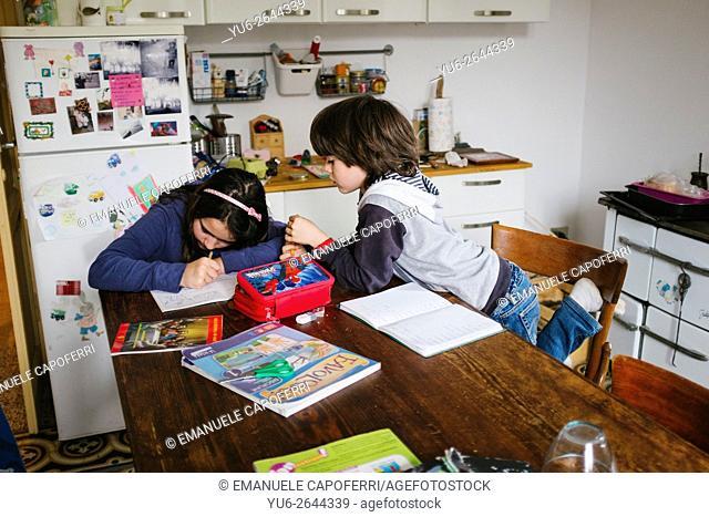 Children place their homework in the kitchen