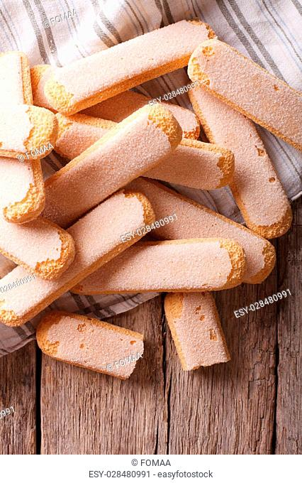 Savoiardi biscuits closeup on a wooden table. vertical top view