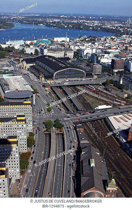 City overview of downtown Hamburg with main train station, center, and sailing boats on the Alster lake, rear, district of St