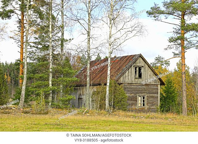 Old wooden house in the country on a day of autumn