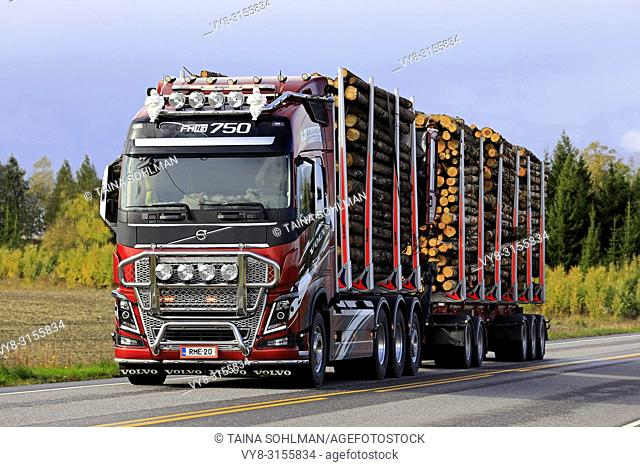 Salo, Finland. September 28, 2018: Customized Volvo FH16 750 logging truck of R. M. Enberg Transport Ab hauls a log load along highway in autumn
