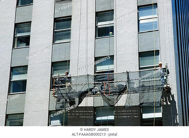 Window cleaning scaffold on side of building