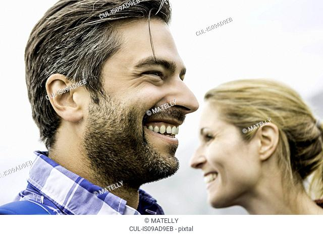 Couple smiling and looking at opposite directions