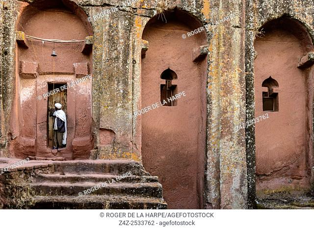 Priets at door to Bete (or Biet) Gebriel-Rufa'el (House of the angels Gabriel, and Raphael). Lalibela. Ethiopia