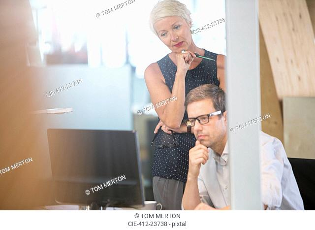 Business people thinking together in office