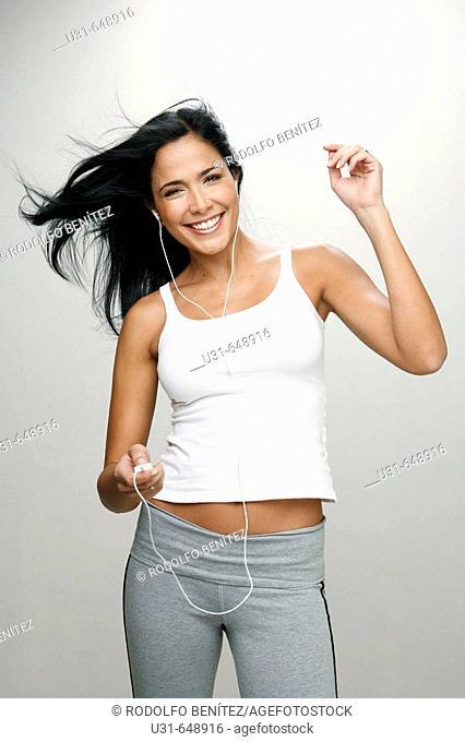Latin girl listening and enjoying music