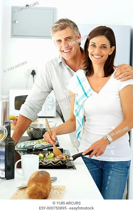 Portrait of a smiling mature preparing food together at home