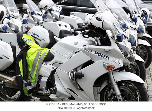 Police MCs in row, a jacket left on the seat. Denmark