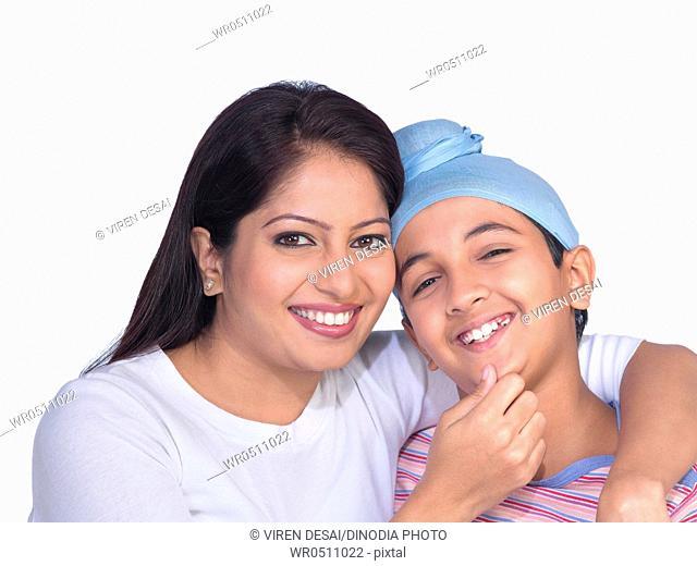 Sikh lady holding chin of son MR702Z,702Y