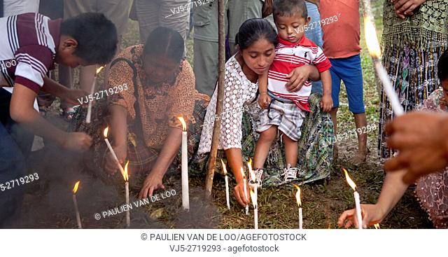 Chahal, Alta Verapaz, Guatemala, Maya tribe, burning candles are put into the ground for a good harvest and gratitude