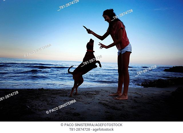 Girl, Girl playing with her dog on Alcocebre beach, Castellon