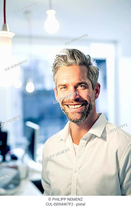 Graying man looking at camera smiling