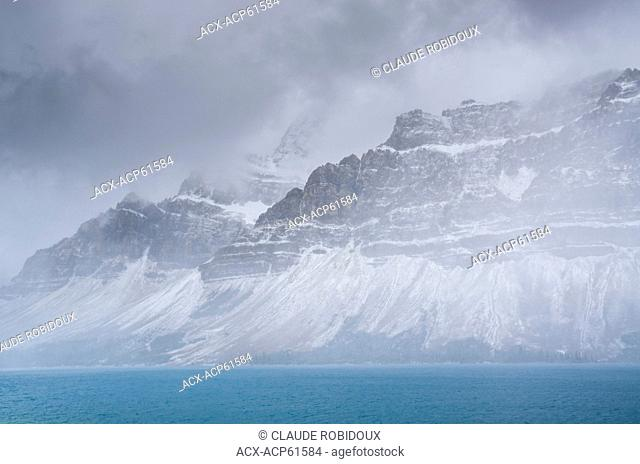 Snow storm over Bow Lake and Crowfoot mountain in Banff National Park, Alberta, Canada