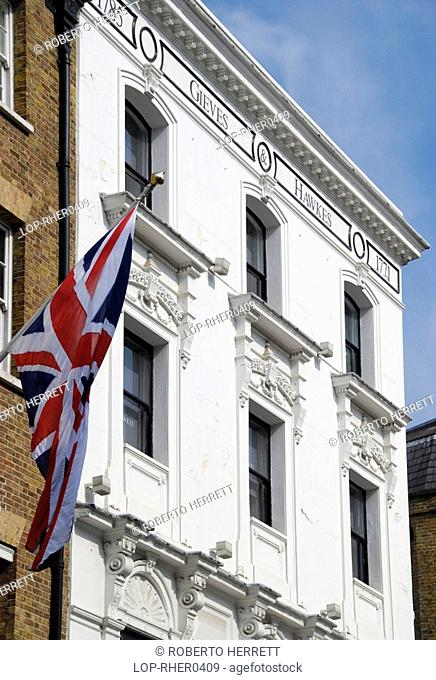 England, London, Saville Row, A British flag hangs above Gieves and Hawkes tailors on Saville Row