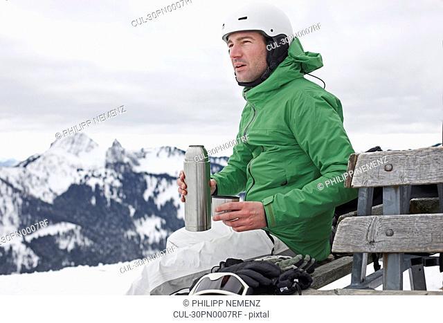 Man in mountains taking a break