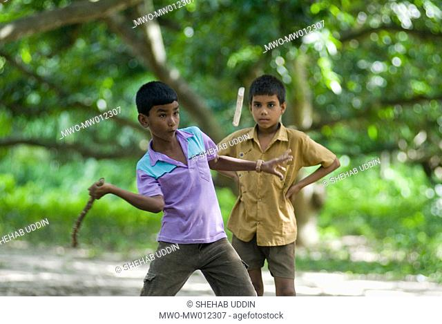 Children playing a game of dangguli, a traditional game in Bangladesh, in the village of Meherpur Bangladesh June 28, 2007