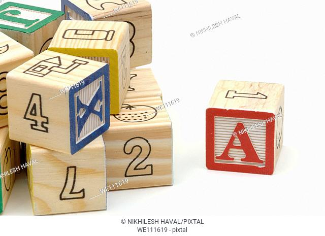 Childrens Arabic numbers English alphabets and pictures learning wooden blocks on white background