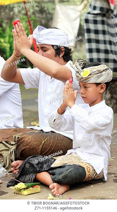 Indonesia, Bali, Mas, temple festival, people praying, odalan, Kuningan holiday