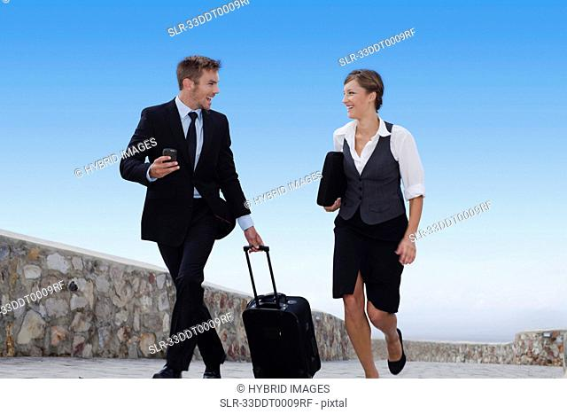 Business people running with luggage