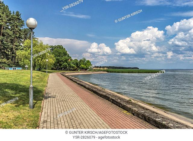 Seaside promenade Nida on the Curonian Lagoon. Nida (Nidden) is a village on the Curonian Spit to the Baltic Sea. The village is located on the lagoon side of...
