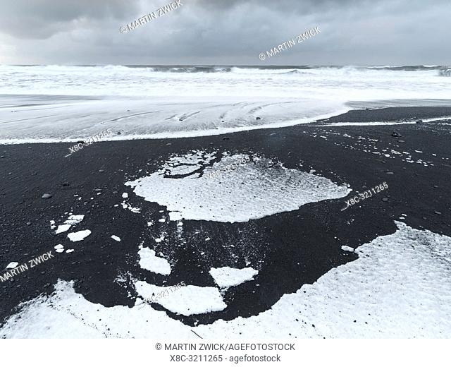 The coast of the north atlantic near Vik y Myrdal during winter. Black volcanic beach with the sea stacks Reynisdrangar. Europe, Northern Europe, Scandinavia