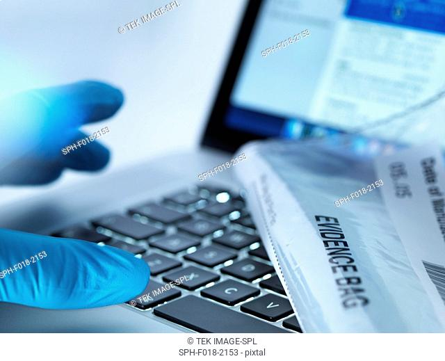 Forensic evidence about to be collected from a laptop computer during a cyber crime investigation