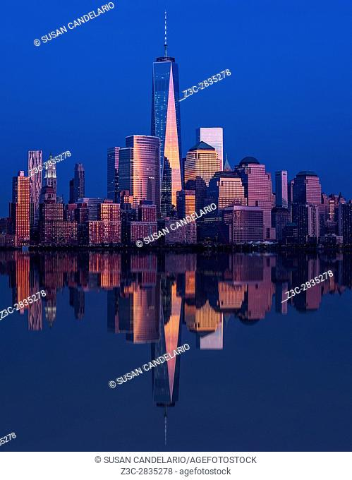 World Trade Center Reflections - Lower Manhattan, New York City skyline with the commonly known as the Freedom Tower along with other skyscrapers in the...