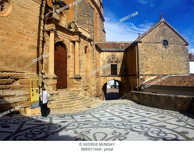 Tourist beside the Church Mayor of Santa María de la Encarnación,