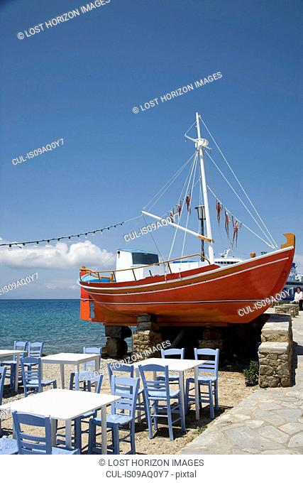 Harbor restaurant and fishing boat, Oia, Santorini, Cyclades, Greece