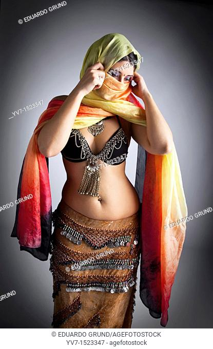 Beautifull belly dancer with veil