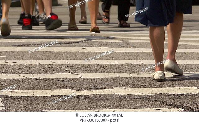 Chicago street scene, pedestrian crossing close up with feet