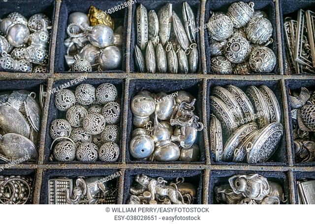 Chinese Replica Silver Jewelry Charms Pendant Panjuan Flea Market Decorations Beijing China. Panjuan Flea Curio market has many fakes