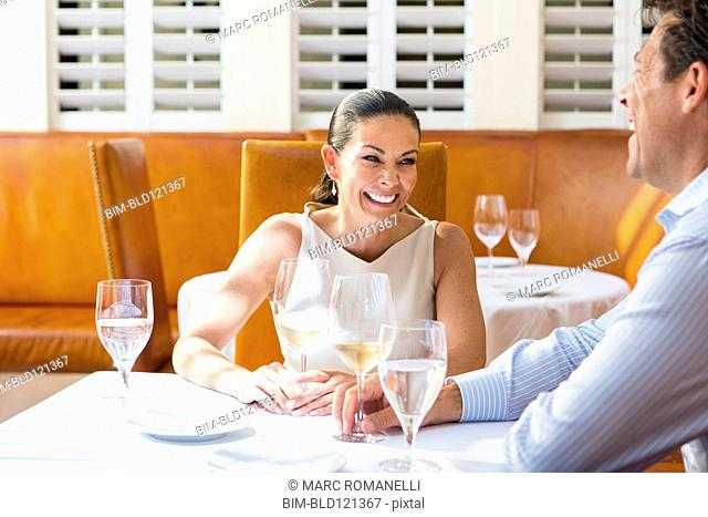 Business people eating at restaurant