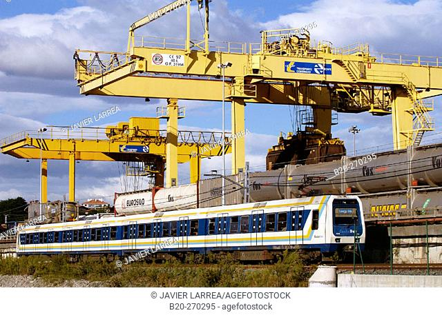 Euskotren with bridge cranes in background. Cross-border freight train station. Irun. Guipuzcoa. Basque Country. Spain