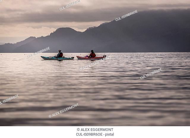 Friends kayaking in lake, Johnstone Strait, Telegraph Cove, Canada
