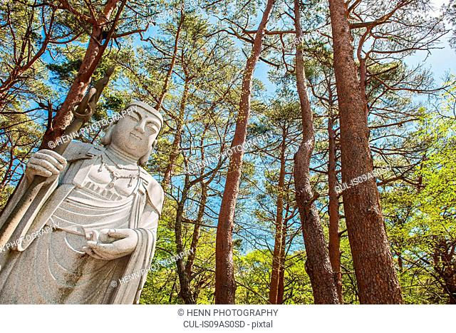 Buddha statue at a temple on Hallasan the highest mountain in Korea, Jeju Island, South Korea