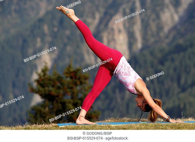 Woman doing yoga and meditation outside. Saint-Gervais. France