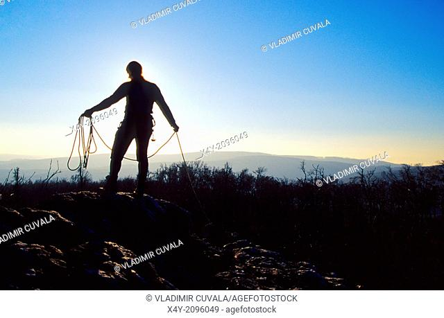 The silhouette of a climber packing his rope, Male Karpaty, Slovakia