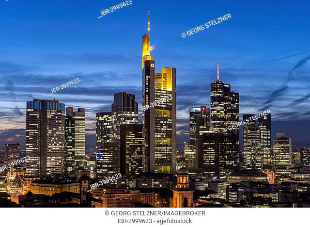 Views of the city skyline at dusk and lit skyscrapers, city centre, Frankfurt am Main, Hesse, Germany