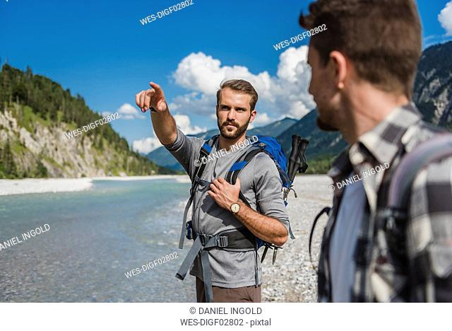 Portrait of hiker pointing on something at distance