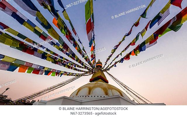 Prayer flags ring the massive stupa of the Boudhanath Temple. It is the largest stupa in Nepal and the holiest Tibetan Buddhist temple outside Tibet