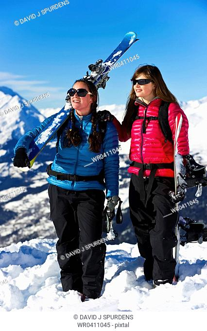 A skier and snowboarder having fun in the snowy mountains