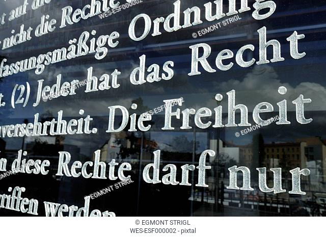 Europe, Germany, Berlin, Close up of german constitution written on glass in front of Bundestag