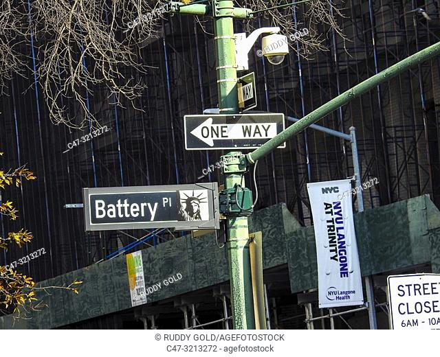 New York City, US. Battery Pl. street sign and traffic indications