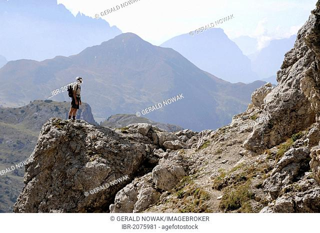 Mountaineer admiring the panoramic views from Mt Kleiner Lagazuoi, Dolomites, South Tyrol, Italy, Europe