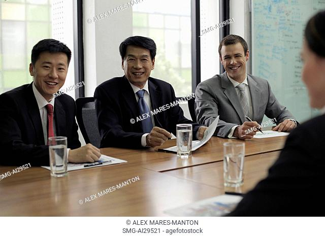 Businessmen having a meeting at a conference table
